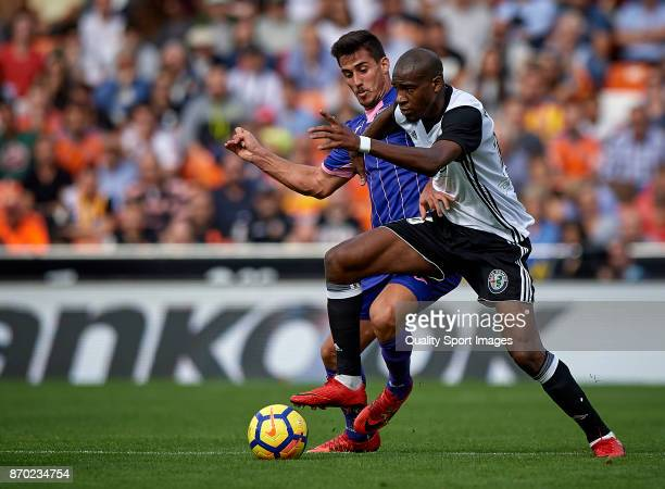 Geoffrey Kondogbia of Valencia competes for the ball with Gabriel Appelt Pires of Leganes during the La Liga match between Valencia and Leganes at...