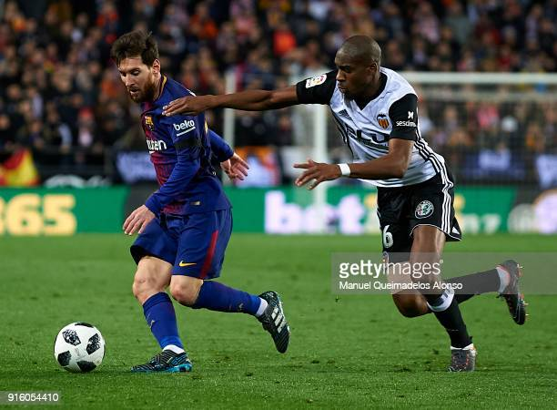 Geoffrey Kondogbia of Valencia competes for the ball with Lionel Messi of Barcelona during the Copa del Rey semifinal second leg match between...