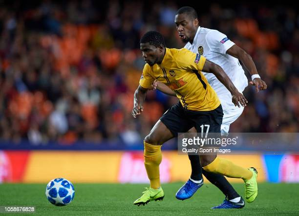 Geoffrey kondogbia of Valencia competes for the ball with Roger Assale of Young Boys during the Group H match of the UEFA Champions League between...