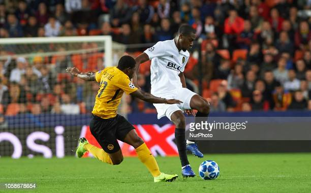 Geoffrey Kondogobia of Valencia CF and Roger Assale of Young Boys during the UEFA Champions League group H match between Valencia FC and Young Boys...