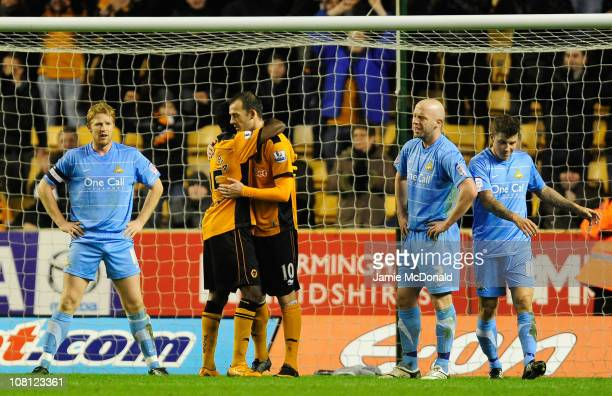 Geoffrey Mujangi Bia of Wolverhampton Wanderers celebrates with team mate Steven Fletcher after scoring his side's second goal during the FA Cup...