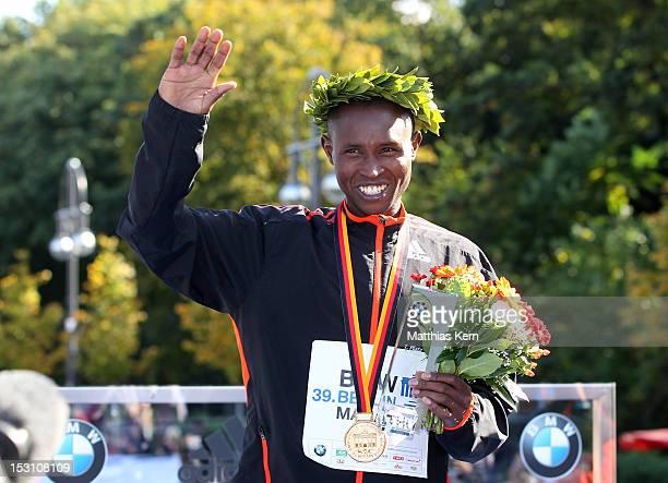 Geoffrey Mutai of Kenya poses after winning the 39th Berlin Marathon on September 30 2012 in Berlin Germany