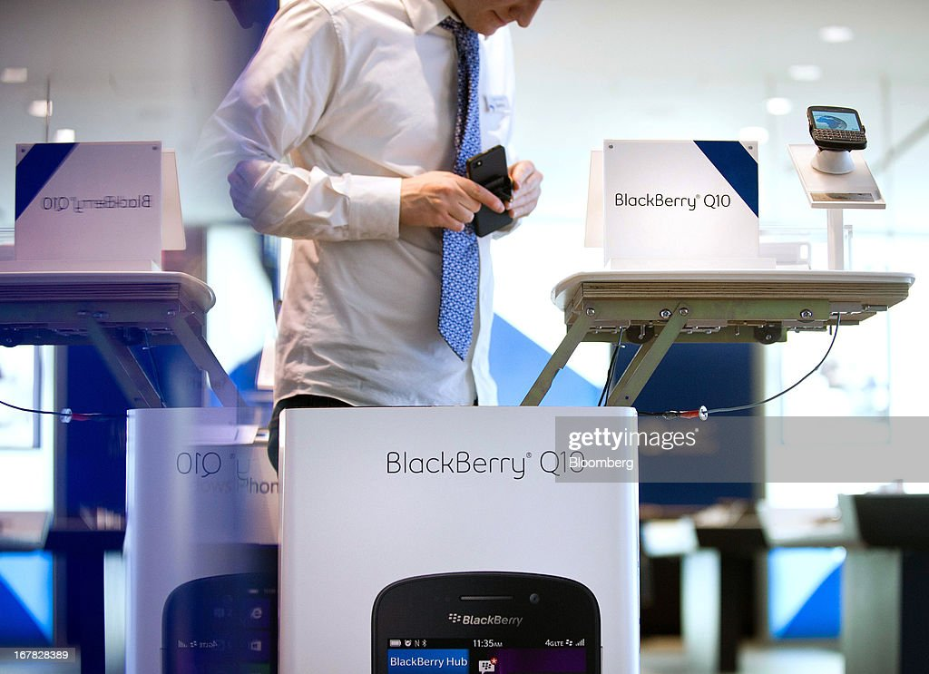 Geoffrey Newsome, sales consultant, prepares a BlackBerry Q10 for display at a Bell Canada retail location in Toronto, Canada, on Tuesday, April 30, 2013. BlackBerry, the Canadian smartphone maker, climbed to its highest level in more than a month after Chief Executive Officer Thorsten Heins said he sees sales of its new Q10 device to be in the 'tens of millions.' Photographer: Galit Rodan/Bloomberg via Getty Images