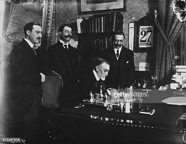 M Geoffrey of France signs a treaty with Senor Garcio Prieto of Spain which recognizes France's right to establish a protectorate over the whole of...