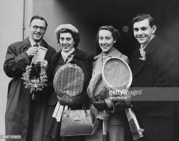Geoffrey Paish, Jean Rinkel-Quertier, Angela Mortimer and John Horn of Great Britain pose for a photograph before departing to play at the...