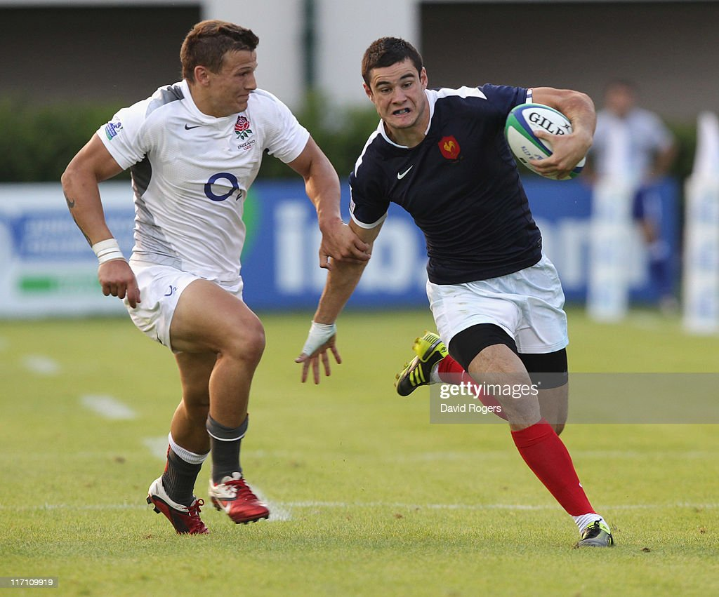 Geoffrey Palis of France moves past Ryan Mills during the IRB Junior World Championship match between England and France at the Stadio Communale di Monigo on June 22, 2011 in Treviso, Italy.