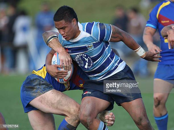 Geoffrey Ruapovo of the Leopards is tackled during the Fox Memorial Championship match between the Otahuhu Leopards and Howick Hornets at Paparoa...