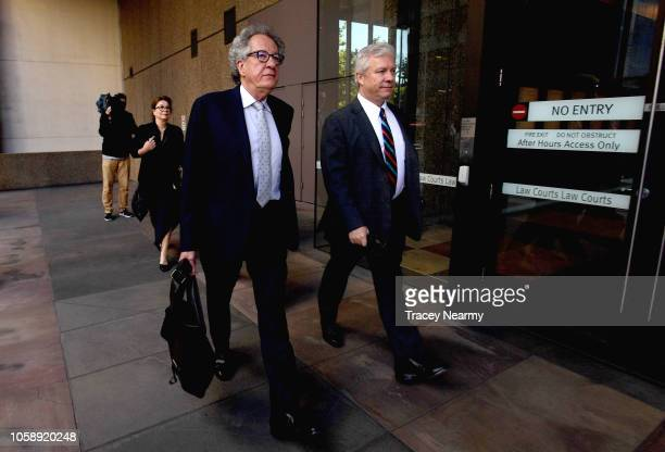 Geoffrey Rush arrives and his wife actress Jane Menelaus arrive at the Federal Law court for a defamation trial against a Sydney newspaper the Daily...