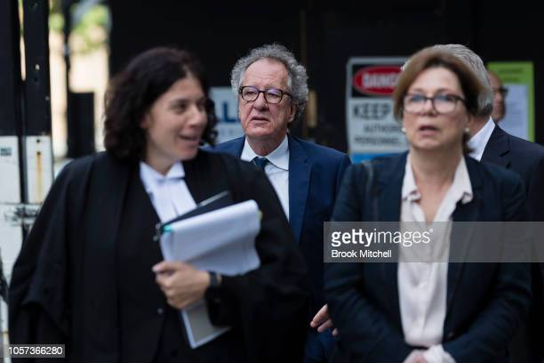 Geoffrey Rush arrives with his legal council and his wife Jane Menelaus at the New South Wales Supreme Court on November 5 2018 in Sydney Australia...