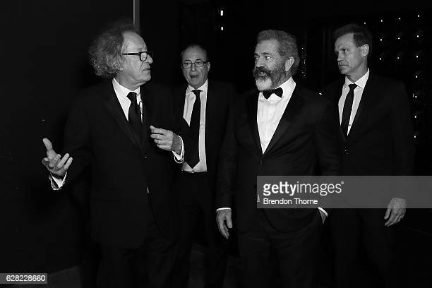 Geoffrey Rush Bruce Davey Mel Gibson and Paul Currie speak backstage during the 6th AACTA Awards Presented by Foxtel at The Star on December 7 2016...
