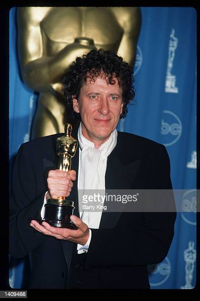 Geoffrey Rush holds his award for Best Performance By An Actor In A Leading Role for the film 'Shine' backstage at the 69th Annual Academy Awards...