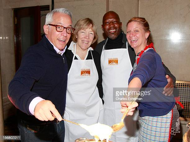 Geoffrey Zakarian Brooke Bailey Johnson Madison Cowan and Amanda Freitag volunteer during the Our Table Is Yours A Thanksgiving Day benefit at...