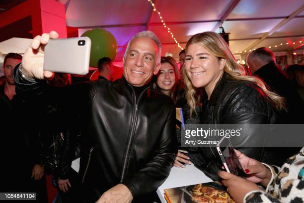 Geoffrey Zakarian takes a selfie with guests during Food Network's 25th Birthday Party Celebration at the 11th annual New York City Wine Food...