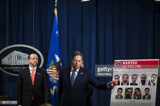 GeoffreyBerman US attorney for the Southern District of New York right speaks during a news conference on cyber law enforcement at the Department of...