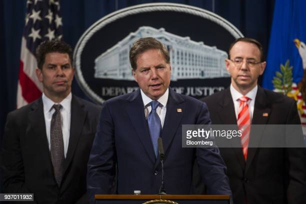 Geoffrey Berman US attorney for the Southern District of New York center speaks during a news conference on cyber law enforcement at the Department...
