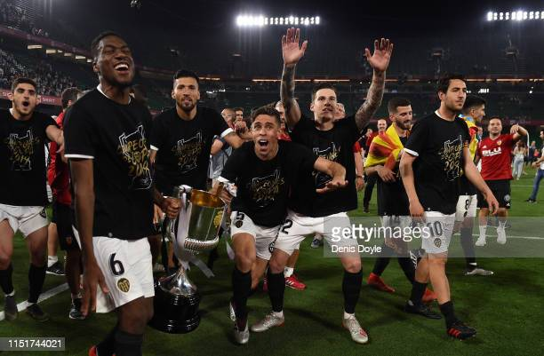 Geoffrey Kondogbia and Gabriel Paulista of Valencia CF celebrate with the trophy at the end of the Spanish Copa del Rey match between Barcelona and...