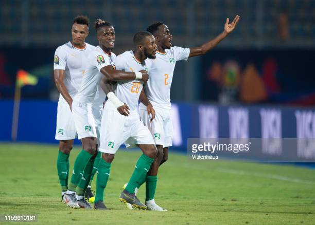Geoffroy Die Serey of Ivory Coast celebrates his goal with Wilfried Zaha, Wonlo Coulibaly and Jean Pphilippe Gbamin, during the 2019 Africa Cup of...