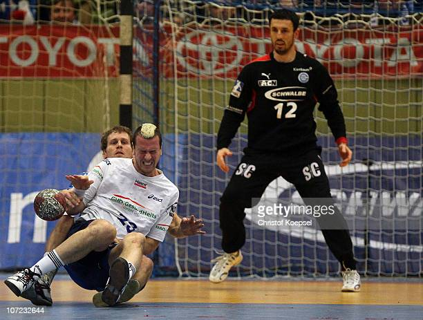 Geoffroy Krantz of Gummersbach challenges Pascal hens of Hamburg during the Bundesliga match between VfL Gummersbach and HSV Hamburg at the...