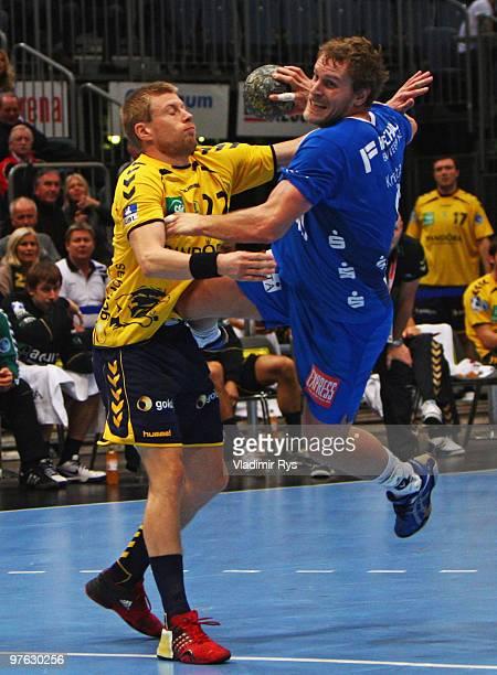 Geoffroy Krantz of Gummersbach shoots on goal defended by Gudjon Valur Sigurdsson of Loewen during the Toyota Handball Bundesliga game between VfL...