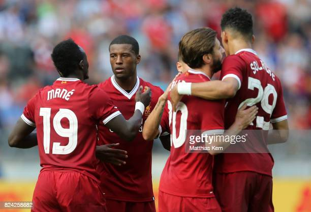 Geoginio Wijnaldum of Liverpool jubilates with team mates after scoring the second goal during the pre season friendly match between Hertha BSC and...