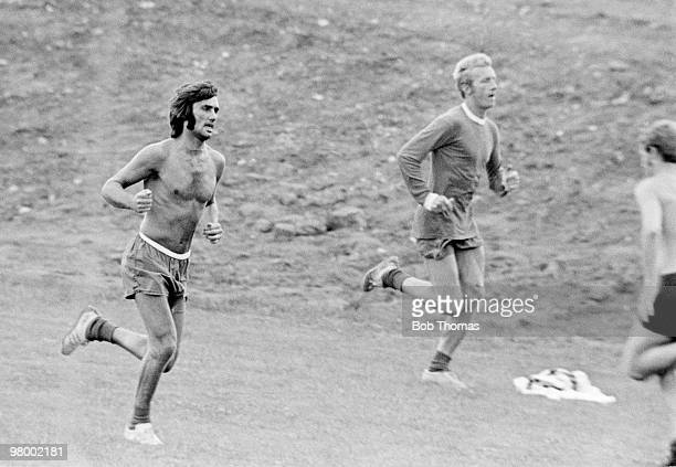 Geogre Best and Denis Law during a Manchester United training session at the Cliff in Manchester circa 1970