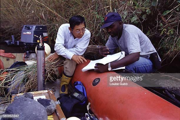 Geologist Aka Festus Tongwa and his former Professor of geophysics from Okayama University Professor Minoru Kusakabe make notes on the rock samples...