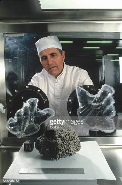 Geologist and Apollo 17 astronaut Jack Schmitt carefully handles a sample of lunar basalt that was collected during the Apollo 15 mission