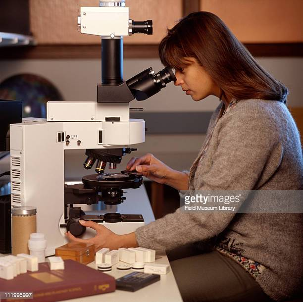 Geologist at microscope at the Field Museum Chicago 1997