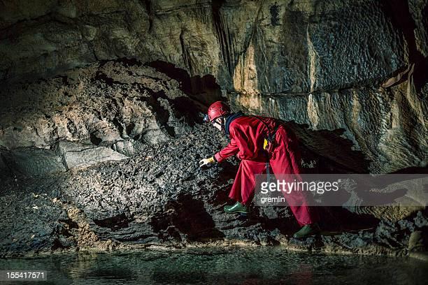 Geologist exploring caves deep underground