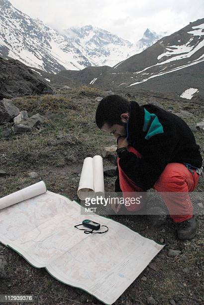 Geologist for the Public Works ministry Sebastian Vivero looks over his maps of the mountains southeast of Santiago. Scientific studies show that...