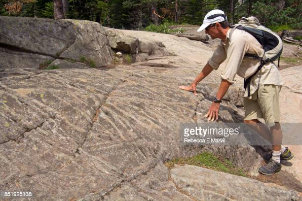 Geologist inspects granite fractures in the French Pyrenees