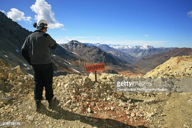 Geologist Next To Explosive Sign In The Andes Looks To Argentina At 4000 m High They have The Best View To Argentina