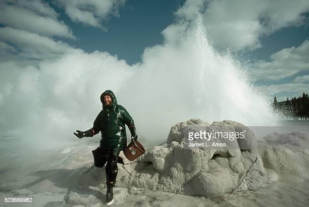 Geologist Retreating From Geyser Eruption