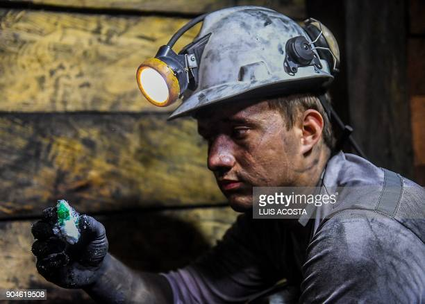 A geologist shows emeralds at a mine in the municipality of Muzo known as the 'emerald capital of the world' in the Colombian department of Boyaca on...