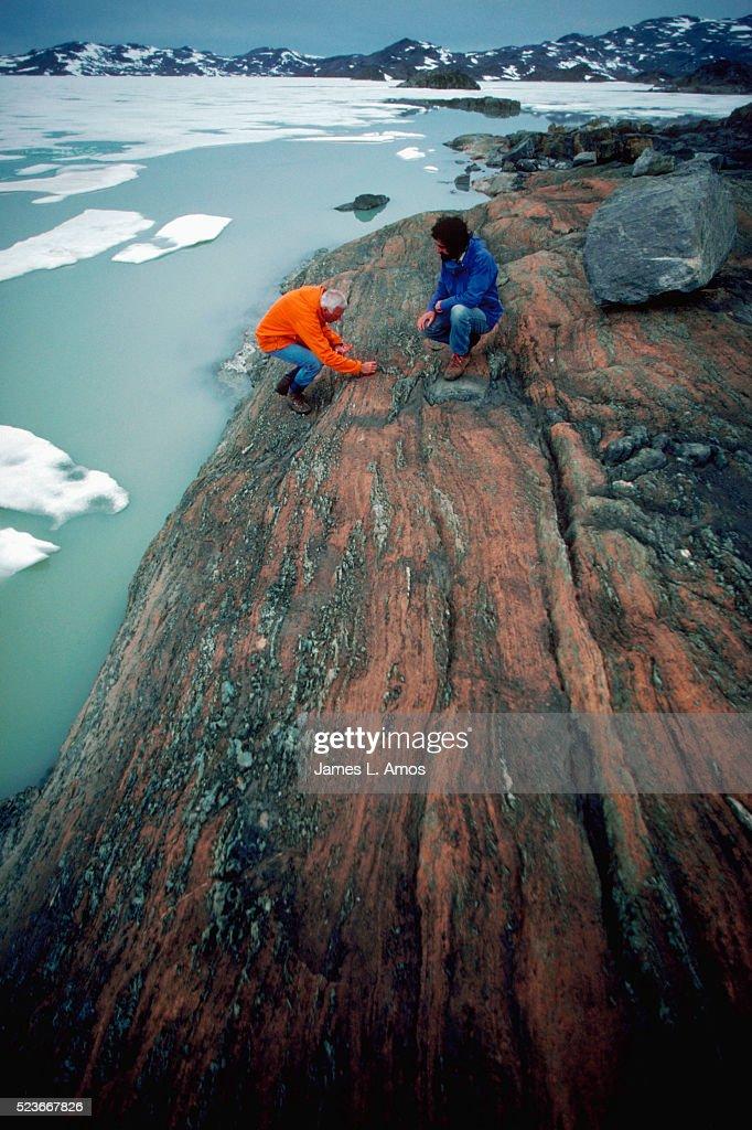 Geologist Studies Rocks in Greenland : Stock Photo
