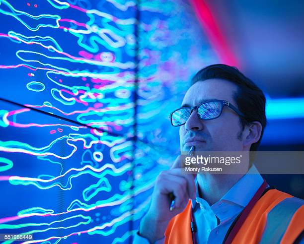 geologist studying graphical display of oil and gas bearing rock on screens, close up - geology stock pictures, royalty-free photos & images