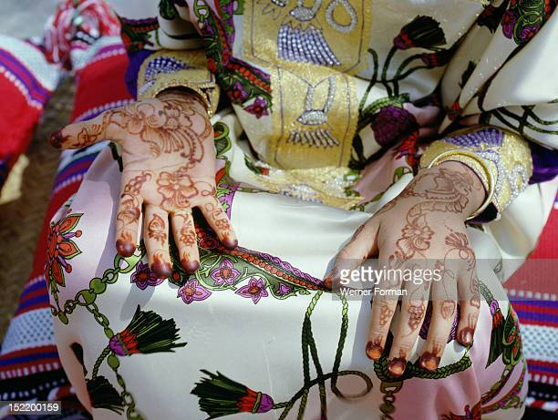 Geometric and floral decorative henna patterns were applied to adorn the hands and feet of young women on occasions such as weddings The black dye...