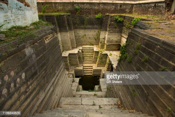 geometric giant step well. - stepwell stock photos and pictures