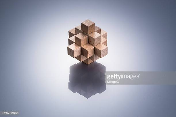 geometric puzzle made out of wood - complicated stock photos and pictures