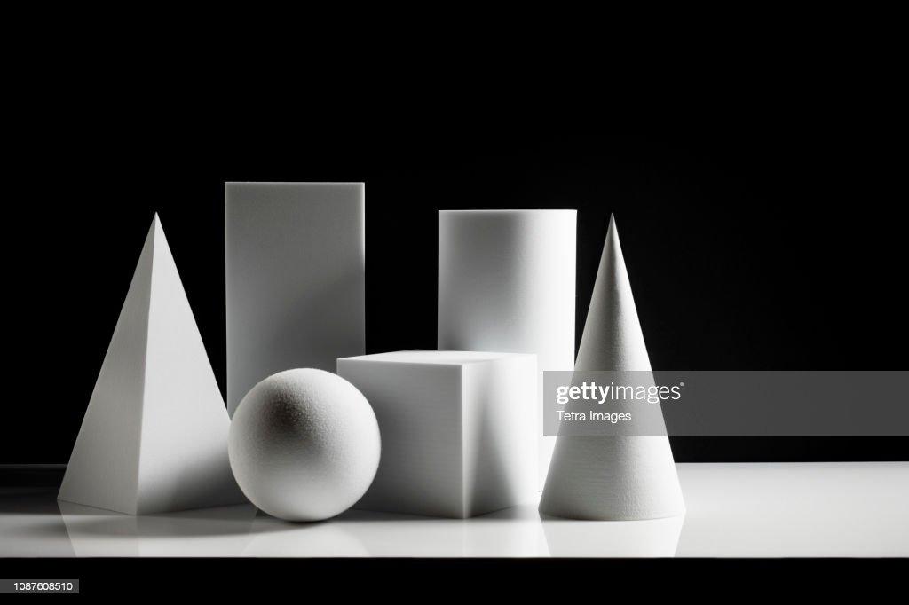 Geometric shapes against black background : Stock-Foto