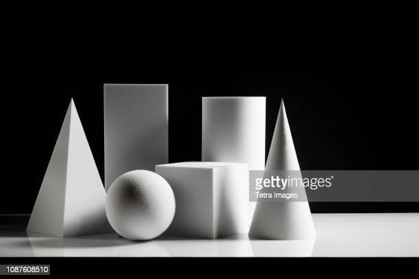 Geometric shapes against black background