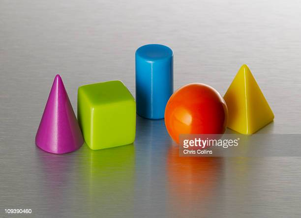 geometric shapes arrangement - cone shaped objects stock pictures, royalty-free photos & images