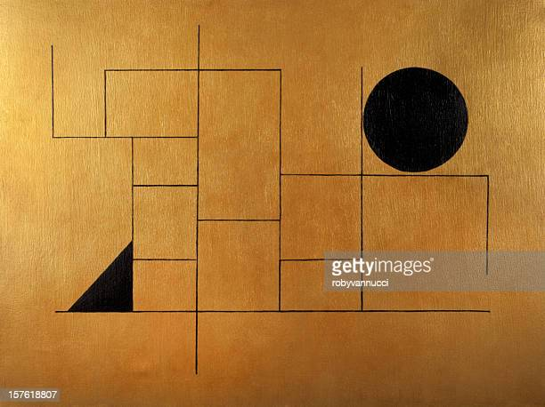 Geometric subject with black sphere and triangle on golden background