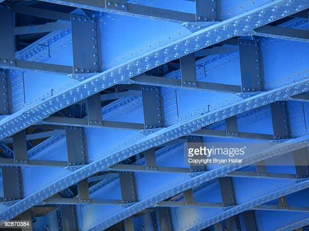 Geometric under side of a blue bridge