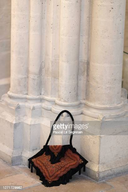 Geometric velvet bag, paisley and pompoms is seen at Conservatoire national des arts et metiers on July 26, 2020 in Paris, France.