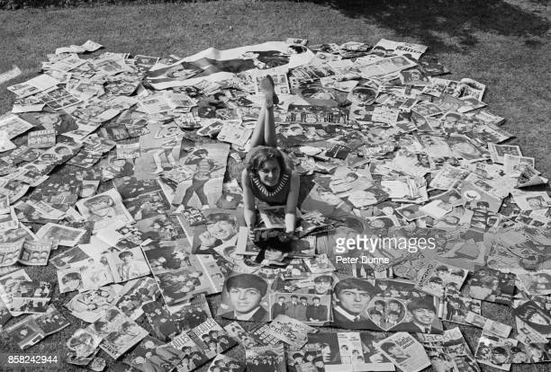 Geone Regester with her collection of photographs of British group The Beatles UK 4th September 1964