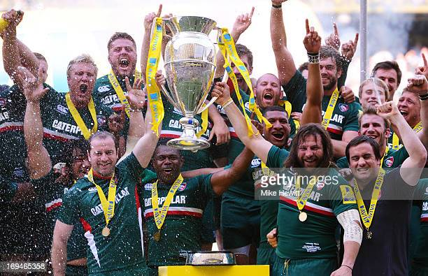 Geordan Murphy and Martin Castrogiovanni of Leicester lift the trophy following their team's 37 17 victory during the Aviva Premiership Final between...