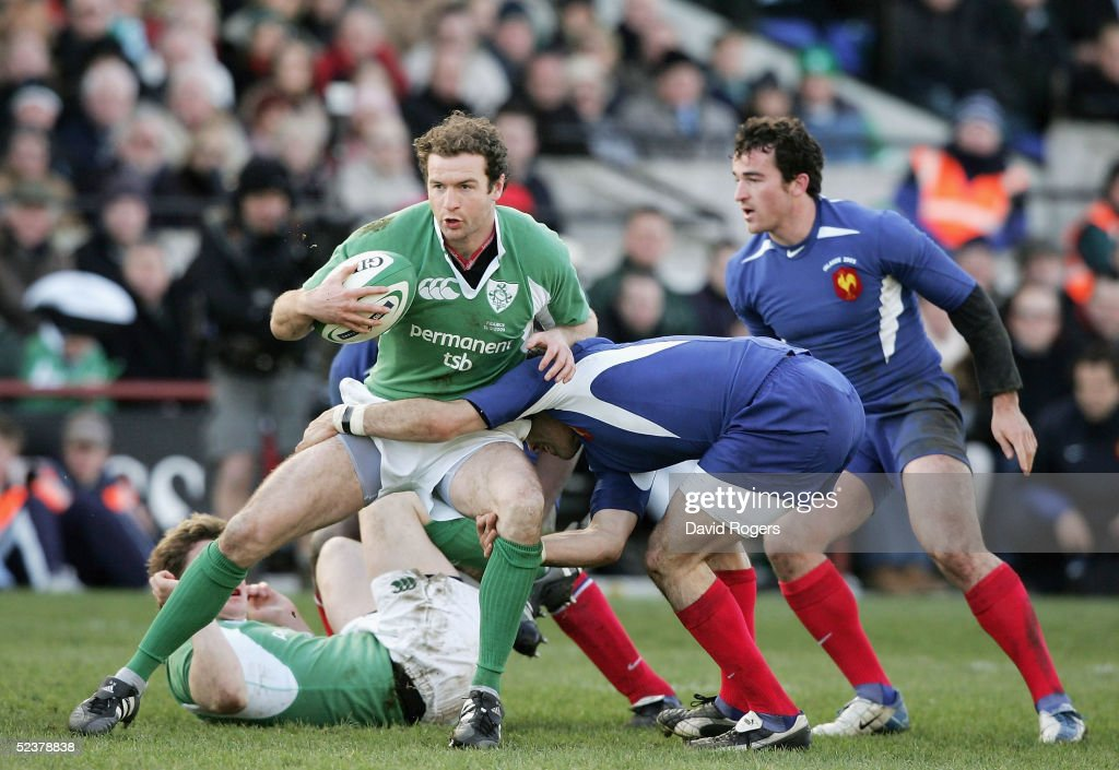 Geordan Murphy of Ireland is tackled by Sylvain Marconnet of France during the RBS Six Nations Championship match between Ireland and France at Lansdowne Road on March 12, 2005 in Dublin, Ireland.