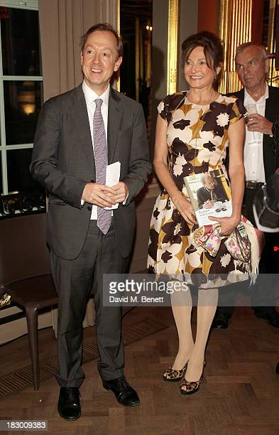 Geordie Greig and Dorrit Moussaieff attend the launch of Geordie Greig's new book Breakfast With Lucian on October 3 2013 in London England