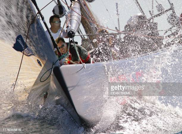 Geordie Shaver on the bow of America's Oracle syndicate yacht 'USA-67' prepares for the spinnaker set as they approach the second windward mark...